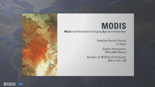 The background is a gray toned map of the Earth. In the foreground and on the left is a orange and brown image that is probably a map. On the right side is some text. The only text that can be made out is the title MODIS.